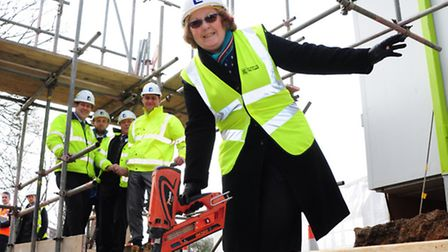 City Council leader Brenda Arthur fixes the timber frame sole plates on the first council homes to b