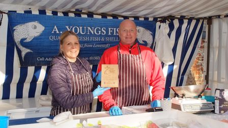 Great Dunmow market traders Clare and Adam of A. Youngs Fish are presented with an Above and Beyond
