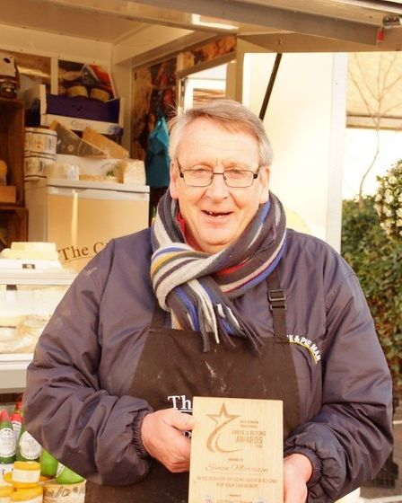 Great Dunmow market trader Simon, the Cheese and Pie Man, is presented with Above and Beyond Awards.