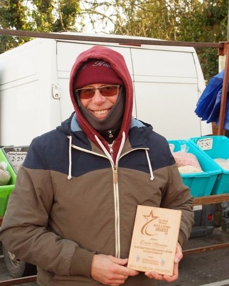 David Newman at Great Dunmow market is presented with an Above and Beyond Award. Picture: ALAN STRAT