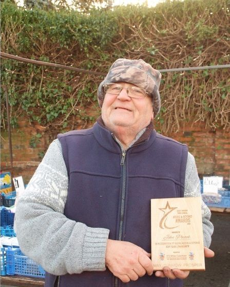 John Pocock of Great Dunmow market is presented with an Above and Beyond Award. Picture: ALAN STRATT