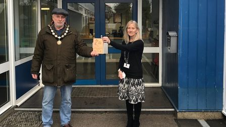 St Mary's Primary School receives an Above and Beyond Award from town mayor Mike Coleman. Picture: S