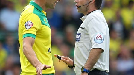 City skipper Russell Martin has a timely chat with referee Paul Tierney during Norwich's win over Wa