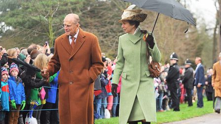 The Duke of Edinburgh and Princess Anne walking to Christmas Day morning service at Sandringham. Pic