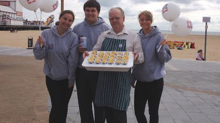 Roger Millward, of Rogers and Son fish and chip shop, with Lo Salt staff on Great Yarmouth seafront.