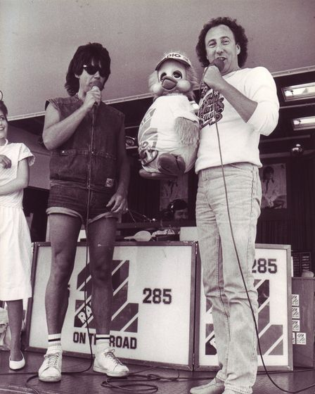 Mike Read, with ventriloquist Keith Harris and Orville on stage at the Radio 1 Roadshow in Great Yar