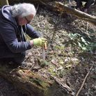 Nigel Lloyd, NNDC's Portfolio Holder for Environment, joins in with community tree planting at Holt
