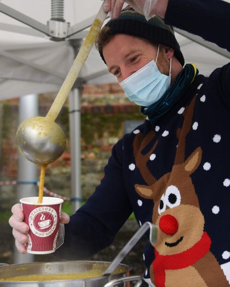 Volunteer Jon Lee serves up the soup at the Norwich Open Christmas for the vulnerable and people in