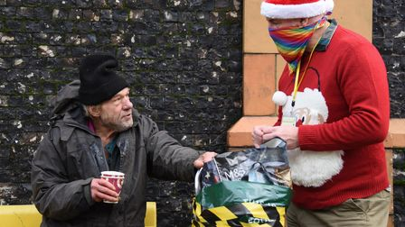 Homeless Peter Brown chats to volunteer Tony Bown at the Norwich Open Christmas on Christmas Day for