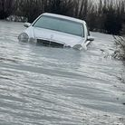 A Mercedes was spotted floating in the flooded Welney Washes today. Local say firefighters had already pulled four cars...