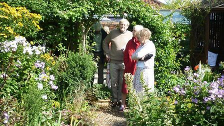 Visitors look at plants at the open gardens event