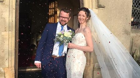 Emma and SamCarrington leavingStAndrew's Church, Chelmondiston, to lots of family and friends throwing confetti over them
