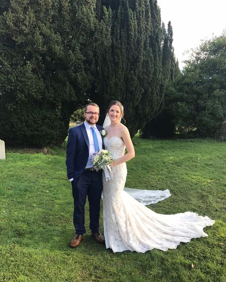 Emma and Sam finally tied the knot on Christmas Day - their sixth wedding date