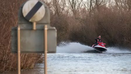Jet skier comes along the A1101 at Welney - showing there's at least one way to travel along the flooded road.