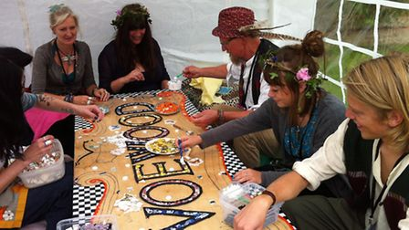 Members of the Norfolk-based Creative Orchard arts collective creating a mosaic at Voewood Festival.