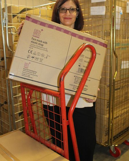 Julie Averies from the James Paget University Hospital holds a box.