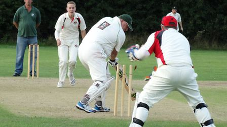 Sprowston B bowler Alex Potter and wicket-keeper Ian Doy in action against Kirkley & Lowestoft Railw