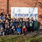 Children and staff from Reepham Primary School with Central England Co-op Reepham team leader Blain Price in front of the...