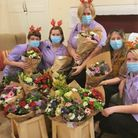 The Gables care home staff with their bouquets of flowers.
