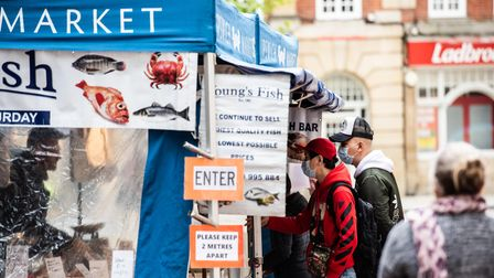 People queue up to get their fish from Youngs market stall