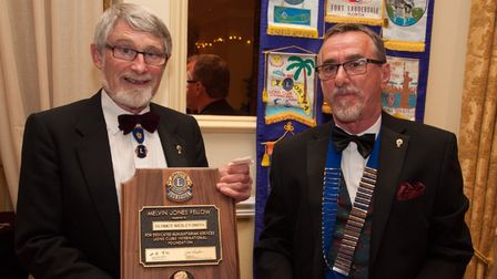 Dermot Wesley Smith recieves the MJF from Beccles Lions president Keith Moore