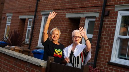 Residents of Cobbold Street, Ipswich, Denise Dye and her mother Pauline Astley waving to their neighbours