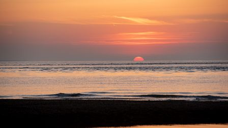 The sun rises at Shingle Street on the hottest day of 2020.