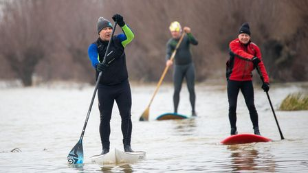 Three paddle borders brave the freezing washes at Whittlesey on Tuesday, December 29.