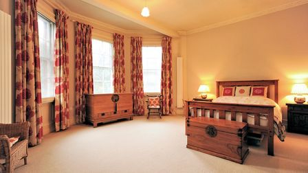 Classic Georgian bedroom with double bed and triple bay window