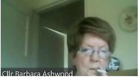 Cllr Barbara Ashwood has apologised after being caught smoking during a virtual meeting of the communities and partnership...