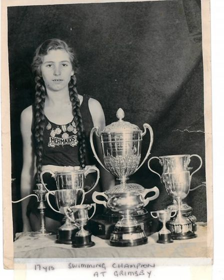 Margaret was a keen swimmer in her younger years and is pictured here with her trophies aged 17