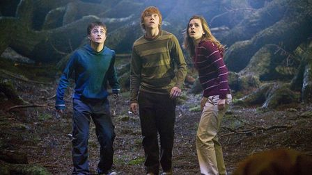 This undated photo supplied by Warner Bros. shows Daniel Radcliffe, left, Rupert Grint, center, and