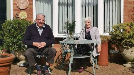 villagers sitting outside their house in hopton