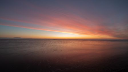 Spectacular sunrise at Shingle Street on the eve of New Year's Eve. Picture: SARAH LUCY BROWN