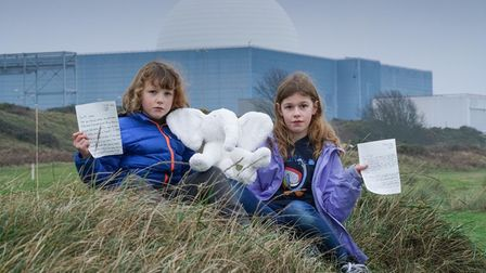 Merran and Evelyn with their letters and white elephant which they sent to the Prime Minister