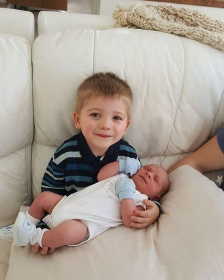 George Benjamin Barker pictured with big brother Fred.