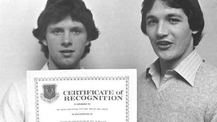 George Burley and Kevin O'Callaghan with a certificate of Recognition awarded to the first team in M