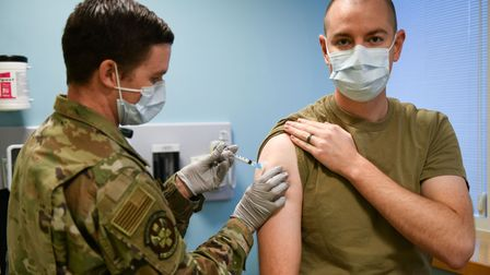 Technical Sgt. Justin Pribble, 48th Medical Group pediatrics/immunology flight chief, administers th