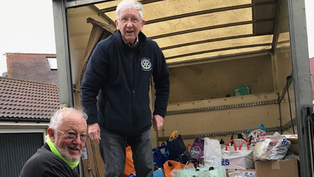 two men with donations for the foodbank