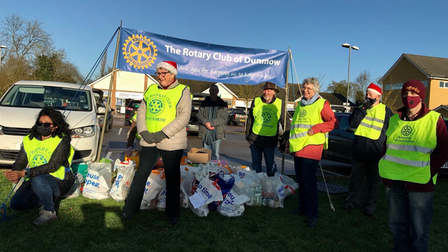 people with a Rotary Club banner