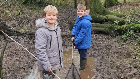 Ashton (left) and Callum Scott, who saved fish that became trapped after the River Gipping burst its banks