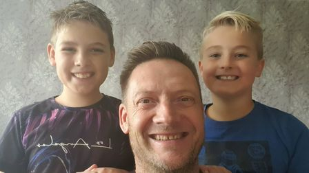 Matt Scott with his sons, who saved more than 100 fish
