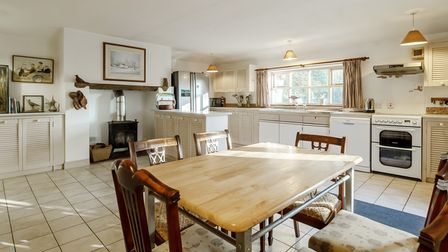 Country style kitchen with large table in the centre