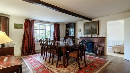 Traditional dining room with eight seat dining table and brick fireplace