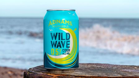 A can of Adnams' alcohol-free cider by the beach
