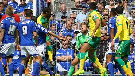 Lewis Grabban heads Norwich City's match-winner to sink Ipswich Town at Portman Road. Picture by Pau