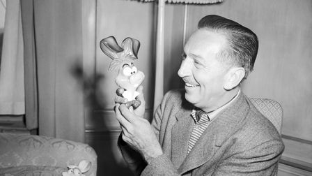 Walt Disney with one of his own creations, the 'March Hare', from his latest cartoon film 'Alice in