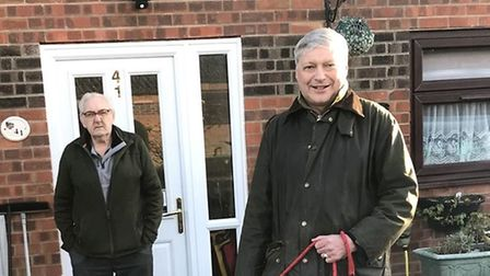 Councillor Ian Martin with a resident after tankers removed raw sewage from Yaxham.