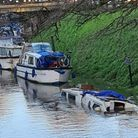 This sunken boat was left submerged in the River Nene at March over the Christmas break.