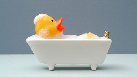 giant rubber duck taking a bath. grey background